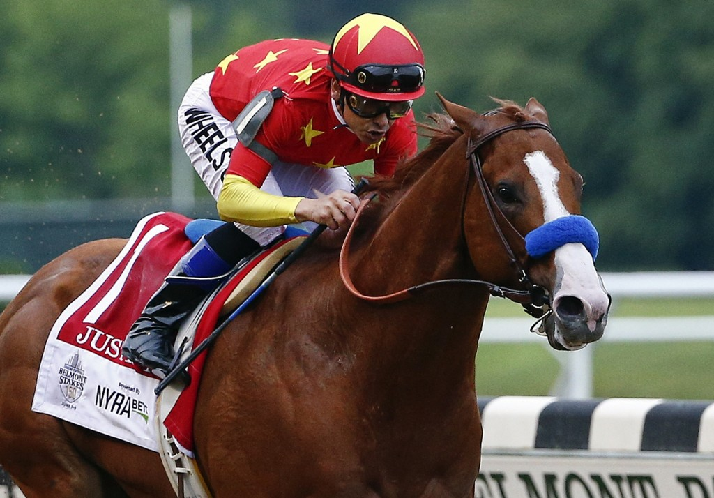 FILE - In this June 9, 2018, file photo, Justify (1), with jockey Mike Smith up, crosses the finish line to win the 150th running of the Belmont Stake...