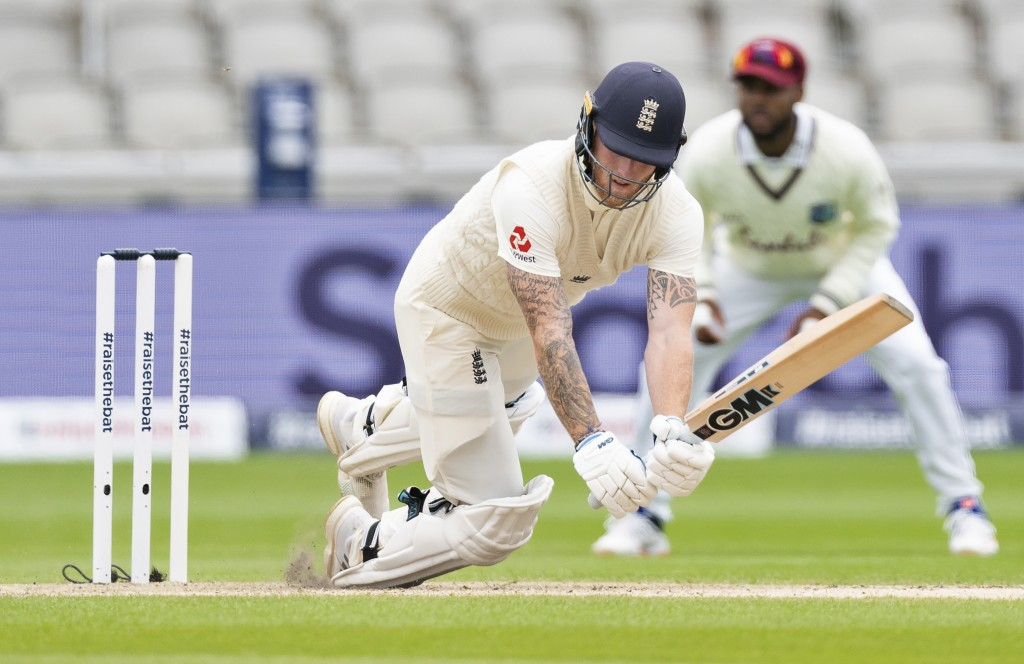 England's Ben Stokes falls after facing a delivery from West Indies' Shannon Gabriel during the second day of the second cricket Test match between En...