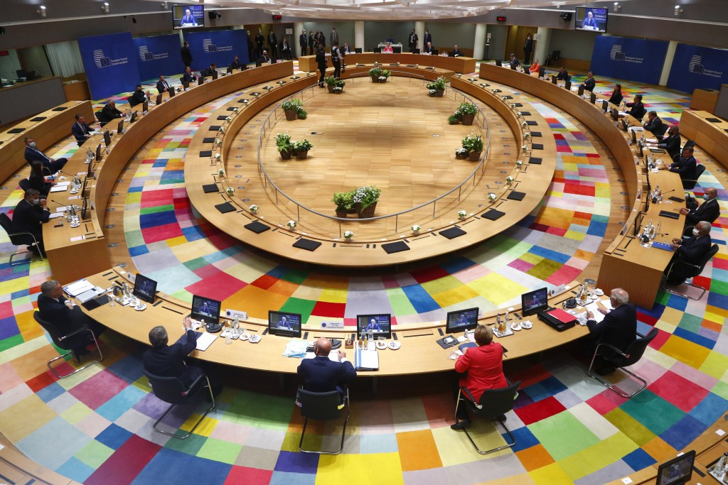 European Union leaders during a round table meeting at an EU summit in Brussels, Friday, July 17, 2020. Leaders from 27 European Union nations meet fa...