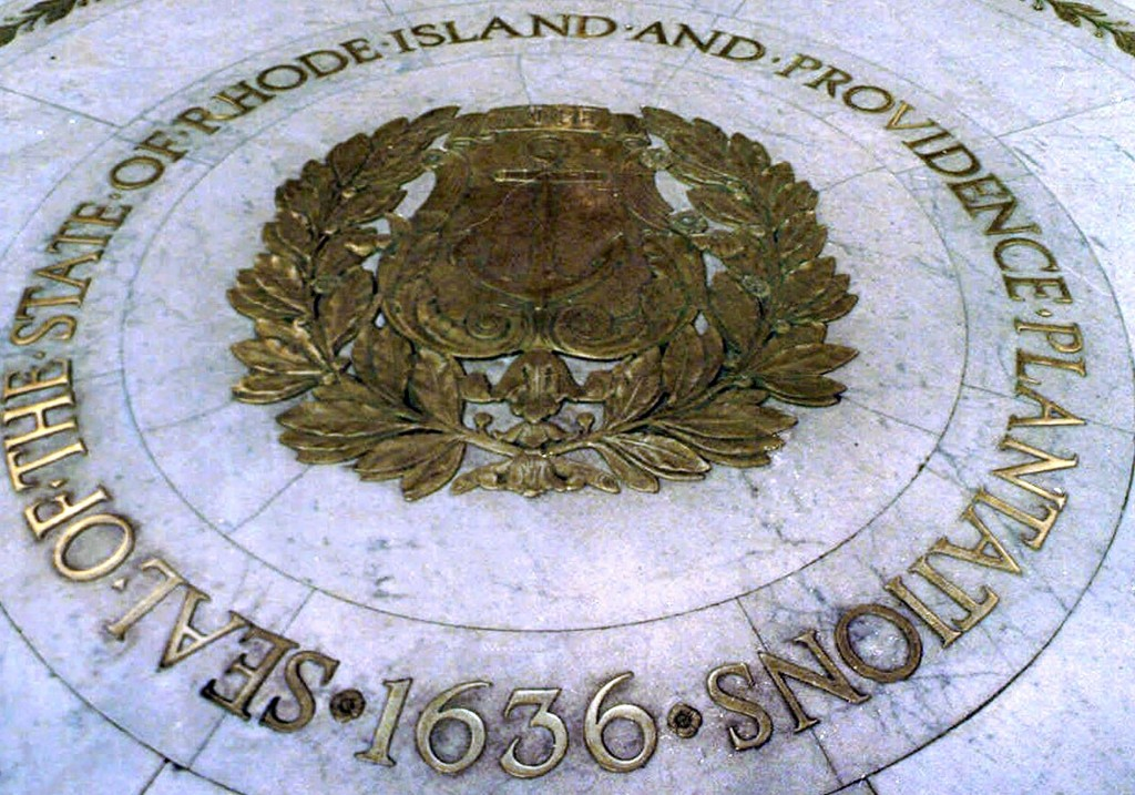 FILE - This Jan. 21, 2000 file photo shows the seal of the State of Rhode Island and Providence Plantations on the floor of the Statehouse rotunda in ...