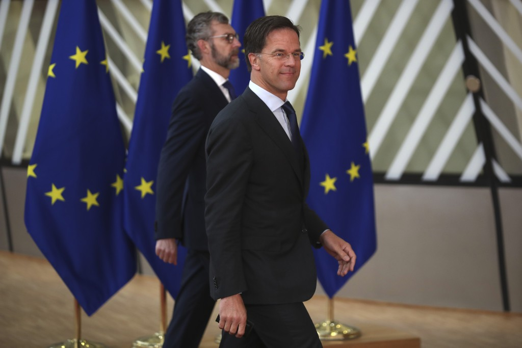 Dutch Prime Minister Mark Rutte, right, arrives for an EU summit at the European Council building in Brussels, Friday, July 17, 2020. Leaders from 27 ...