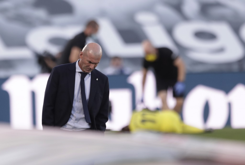 Real Madrid's head coach Zinedine Zidane, walks prior to the Spanish La Liga soccer match between Real Madrid and Villareal at the Alfredo di Stefano ...