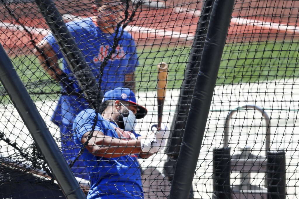New York Mets Wilson Ramos, above, watches Robinson Cano bat in the cage during a summer training camp workout at Citi Field, Thursday, July 16, 2020,...