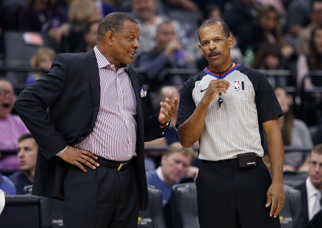 FILE - In this Jan. 4, 2020, fie photo, New Orleans Pelicans head coach Alvin Gentry, left, talks with referee Eric Lewis during the second half of an...