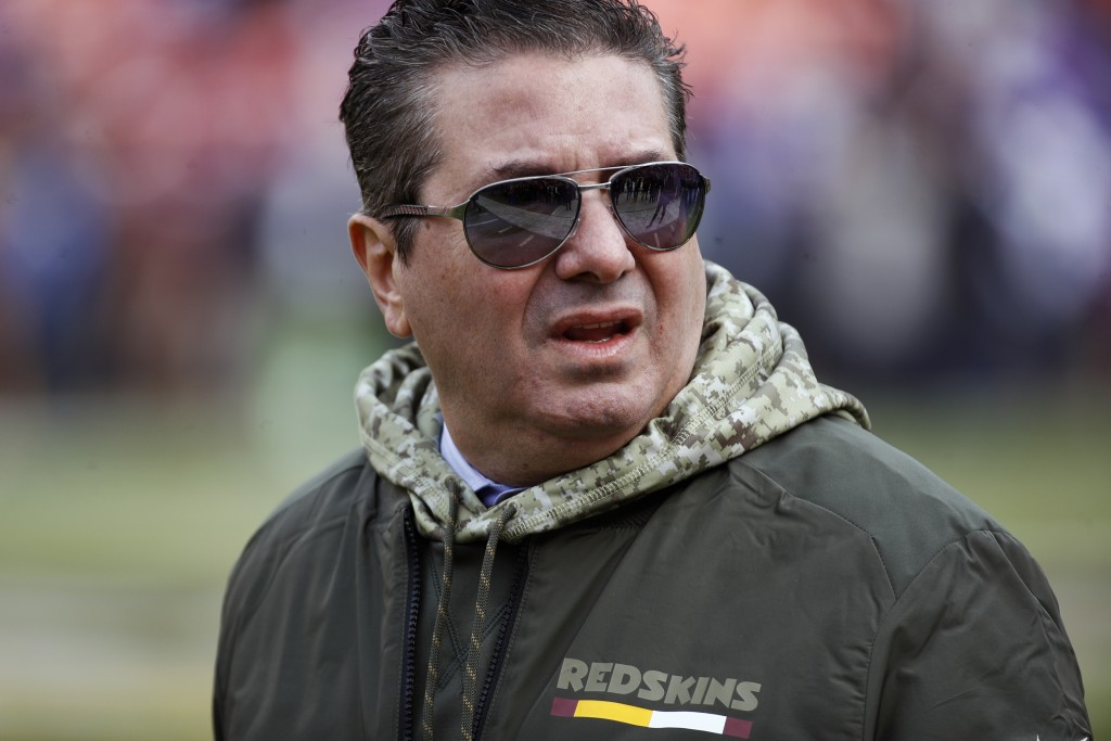 FILE - This Nov. 12, 2017, file photo shows Washington Redskins owner Dan Snyder walking across the field before an NFL football game against the Minn...