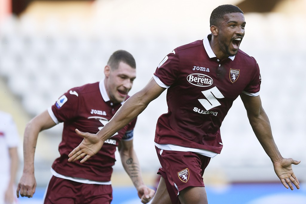 Torino's Gleison Bremer celebrates after scoring his side's opening goal during the Serie A soccer match between Torino and Genoa, at the Olympic Stad...