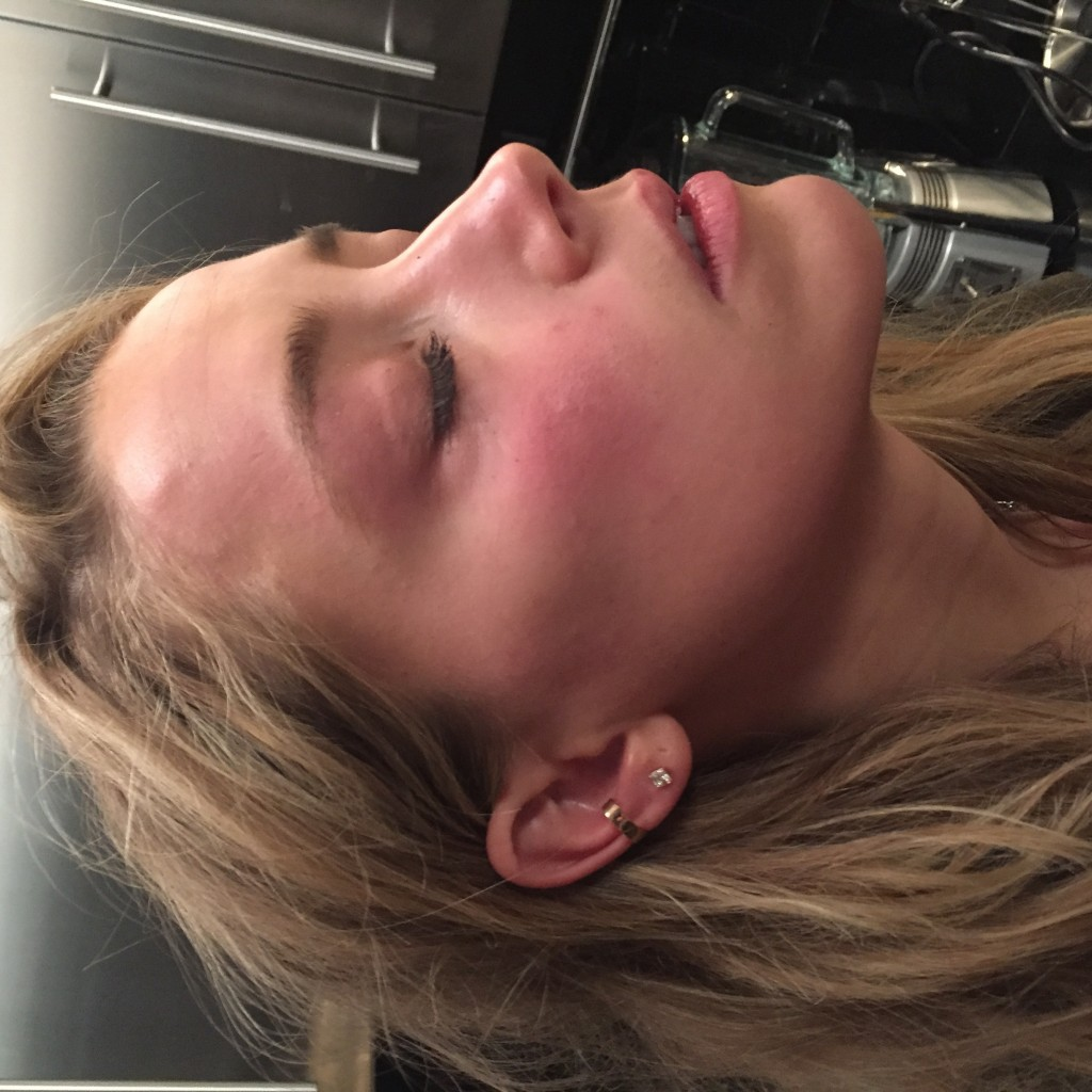This handout photo provided by London High Court shows a photo used in evidence of Amber Heard with marks on her face that she says were inflicted by ...