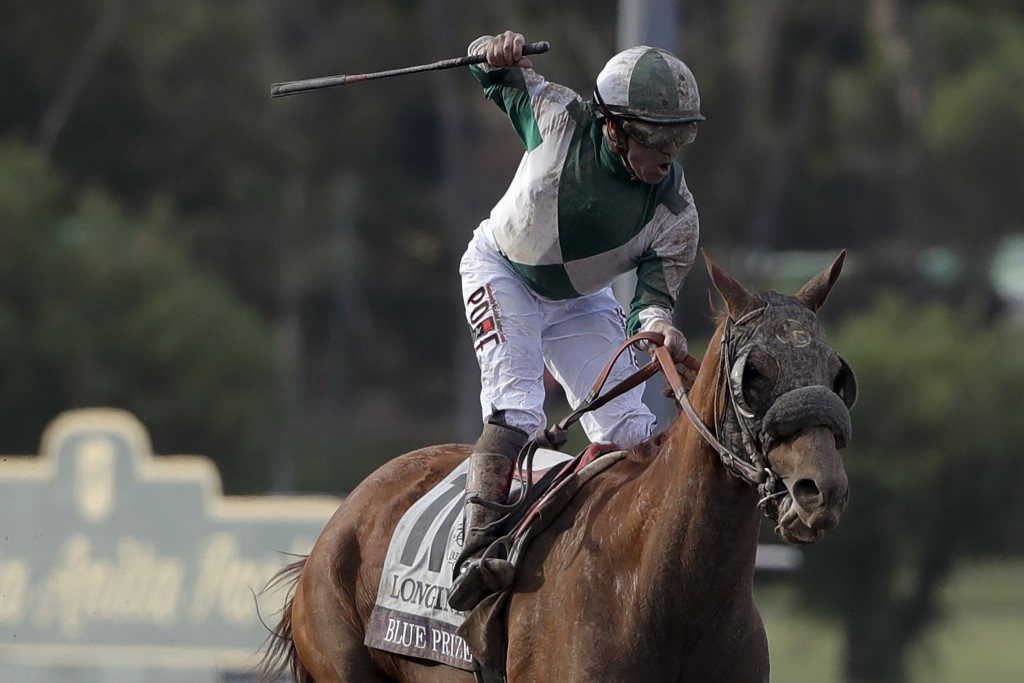 FILE - In this Nov. 2, 2019, file photo, Joe Bravo celebrates aboard Blue Prize after winning the Breeders' Cup Distaff horse race at Santa Anita Park...
