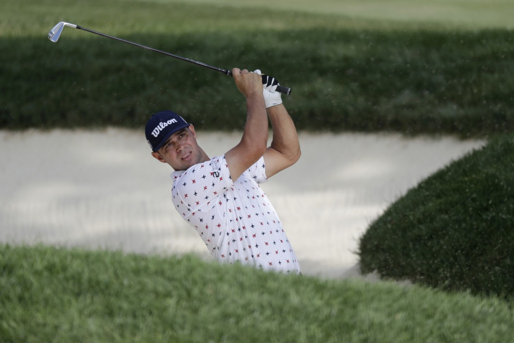 Gary Woodland hits from a bunker toward the 18th green during the second round of the Memorial golf tournament, Friday, July 17, 2020, in Dublin, Ohio...