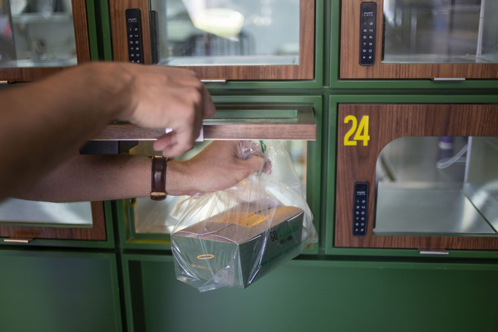 A Go Noodles box is taken by an employee from a glass-paned locker in Tel Aviv, Israel, Thursday, July 16, 2020. The coronavirus crisis and its econom...