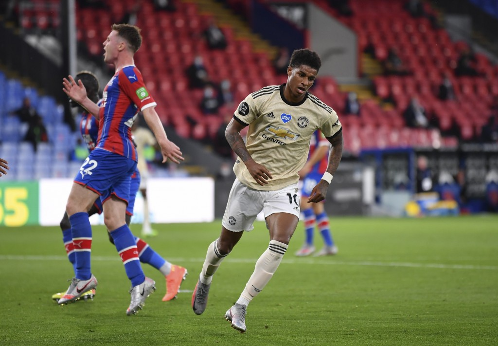 Manchester United's Marcus Rashford trust away after scoring the opening goal during the English Premier League soccer match between Crystal Palace an...