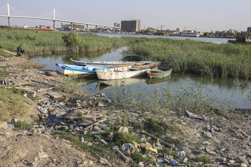Fishing boats sit in the Shatt al-Arab waterway in Basra, Iraq on July 13, 2020. Iraq's Minister of Water Resources is sounding the alarm over looming...