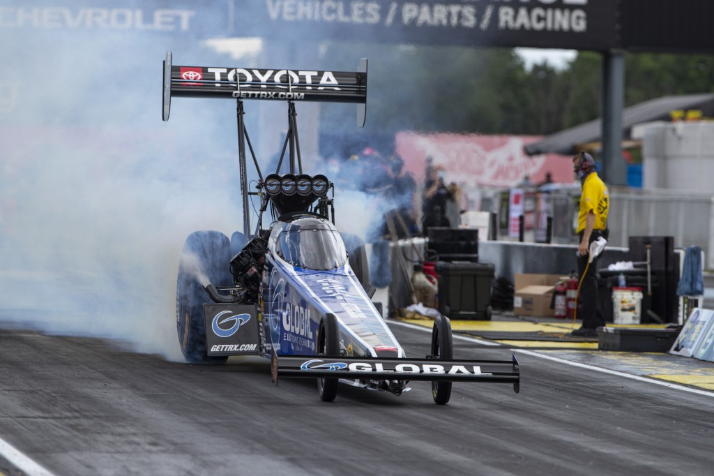 Tony Schumacher does a burnout in a Top Fuel practice run for an NHRA drag racing event in Brownsburg, Ind., Friday, July 10, 2020. The NHRA returned ...