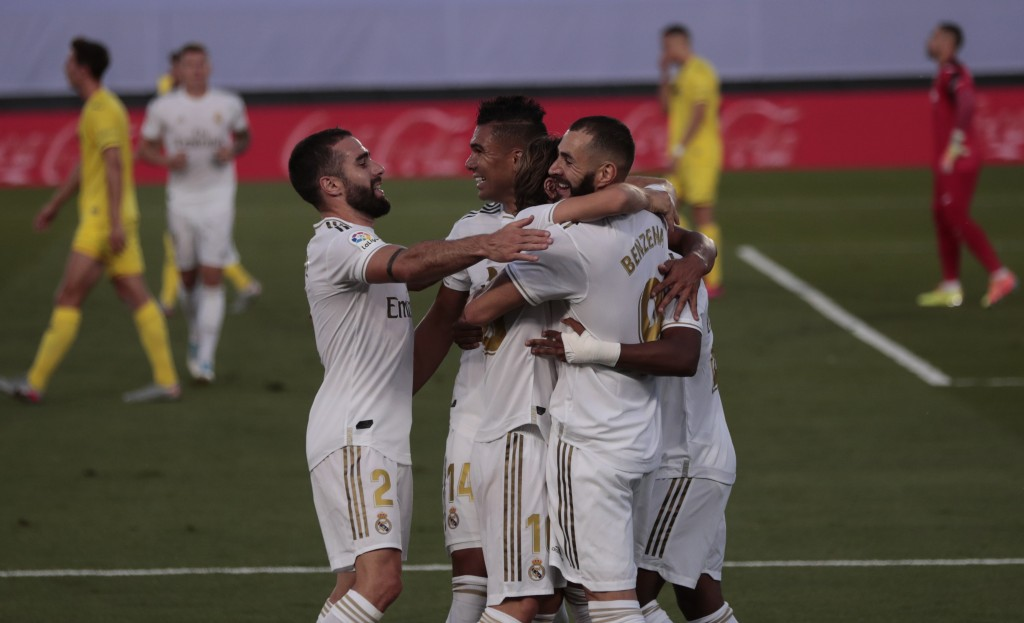 Real Madrid's Karim Benzema, right, celebrates with his teammates after scoring during the Spanish La Liga soccer match between Real Madrid and Villar...