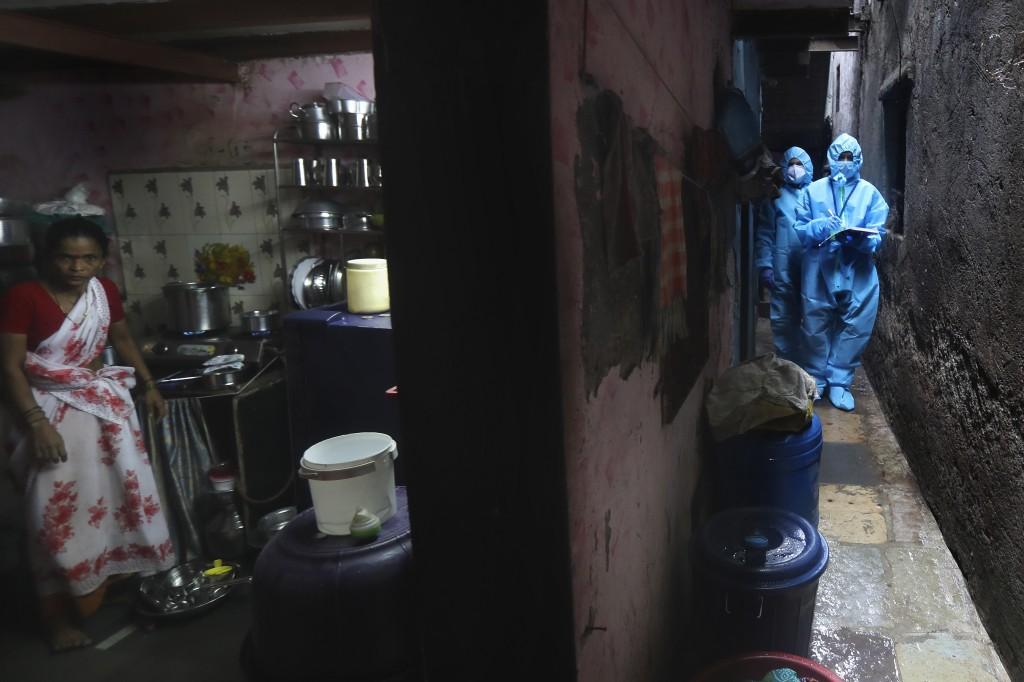 Health workers screen people for COVID-19 symptoms at a slum in Mumbai, India, Tuesday, July 14, 2020. (AP Photo/Rafiq Maqbool)