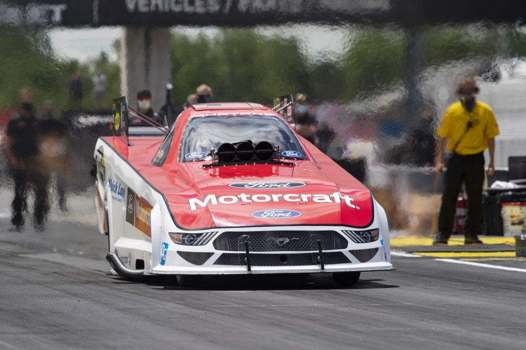 Jonnie Lindberg launches a Funny Car from the starting line on a practice run for an NHRA drag racing event in Brownsburg, Ind., Friday, July 10, 2020...