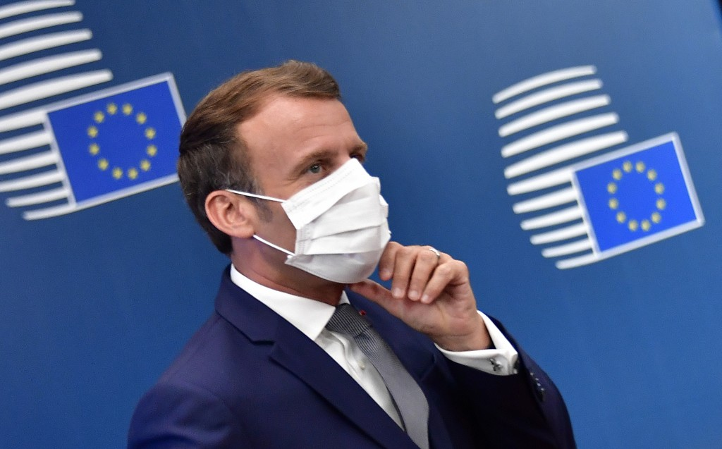 French President Emmanuel Macron arrives for an EU summit at the European Council building in Brussels, Friday, July 17, 2020. Leaders from 27 Europea...