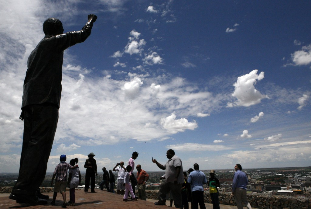 FILE - In this Dec. 12, 2012 file photo, a giant statue of former president Nelson Mandela overlooking the city of Bloemfontein, South Africa. Mandela...