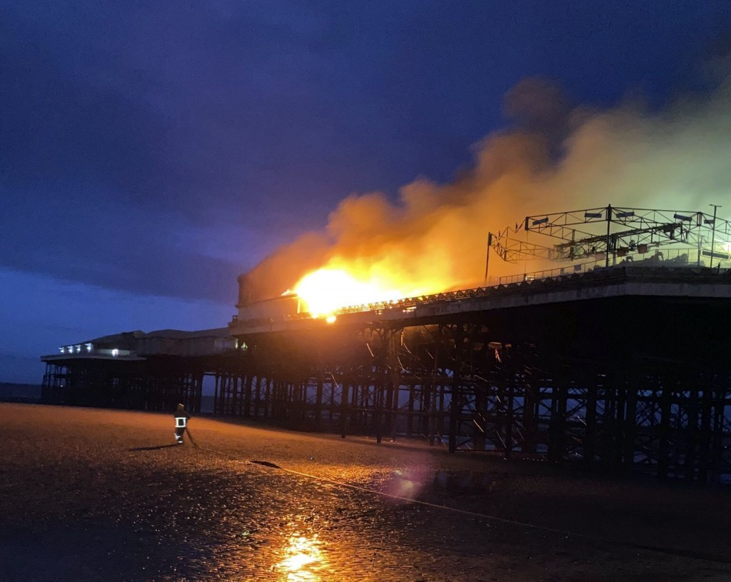 This photo supplied by Lancashire Fire and Rescue Service, shows a fire on Blackpool pier in the early hours of Friday July 17, 2020. (Lancashire Fire...