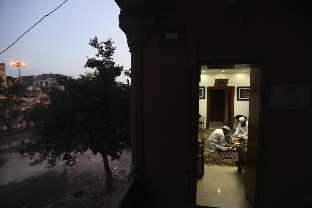Muslim priests break the fast in the deserted Jama Masjid, that is usually packed with thousands of devotees during the holy month of ramadan, because...