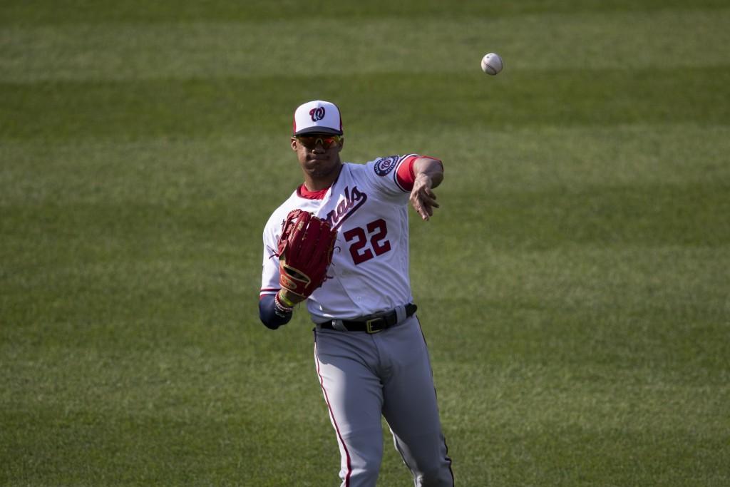 Washington Nationals left fielder Juan Soto warms up before a baseball intrasquad game at Nationals Park, Thursday, July 16, 2020, in Washington. (AP ...