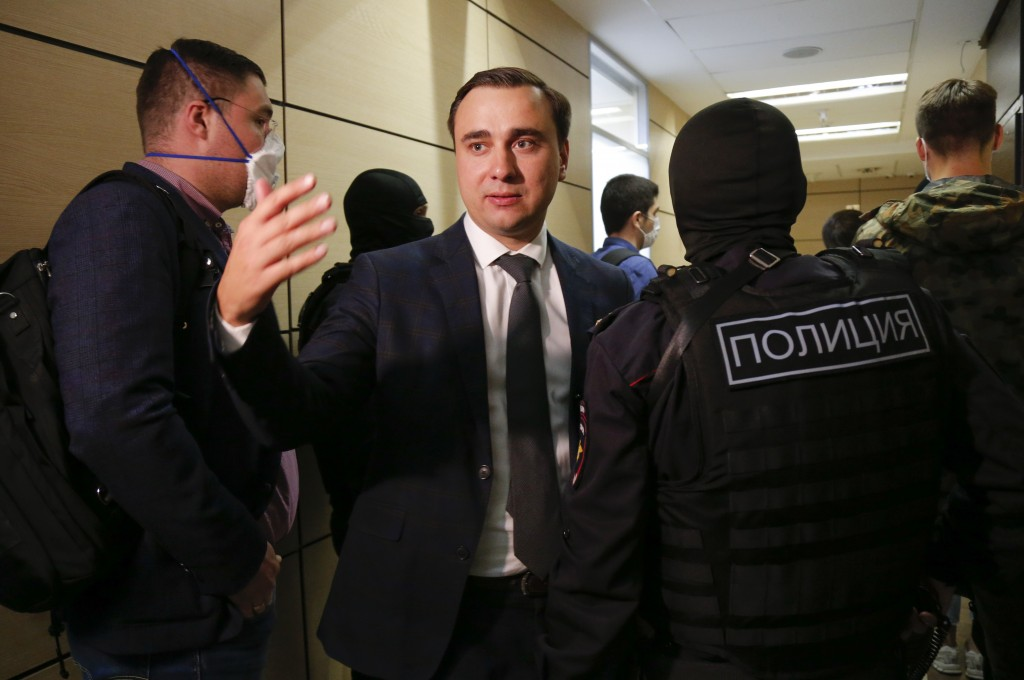 Russian opposition leader Ivan Zhdanov speaks to the media as police raids the offices of Alexei Navalny's Foundation for Fighting Corruption in Mosco...