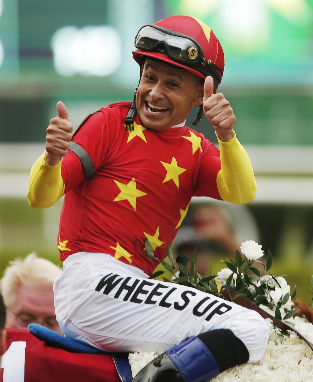 FILE - In this June 9, 2018, file photo, jockey Mike Smith reacts after guiding Justify to win the Triple Crown after the 150th running of the Belmont...