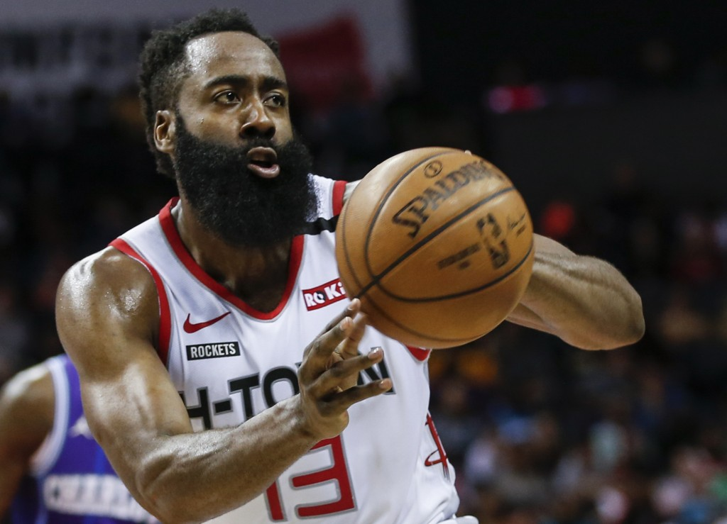 FILE - In this Saturday, March 7, 2020, file photo, Houston Rockets guard James Harden passes against the Charlotte Hornets during the second half of ...