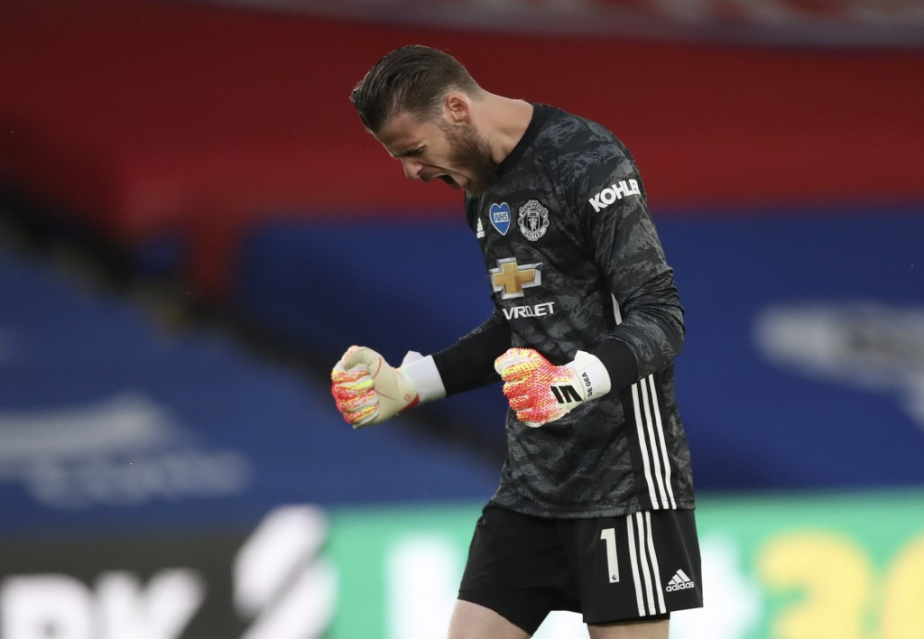 Manchester United's goalkeeper David de Gea celebrates after Manchester United's Marcus Rashford scored the opening goal during the English Premier Le...