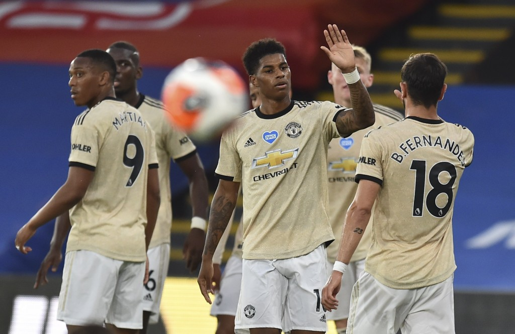Manchester United's Marcus Rashford, center, celebrates after scoring the opening goal during the English Premier League soccer match between Crystal ...