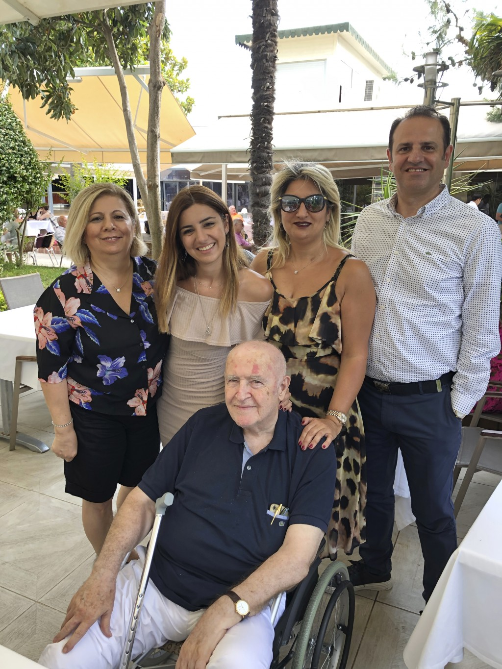 In this family photo provided by Dr. Caner Dilmener, Dr. Murat Dilmener, seated in a wheelchair, a professor of infectious diseases in Istanbul is pic...