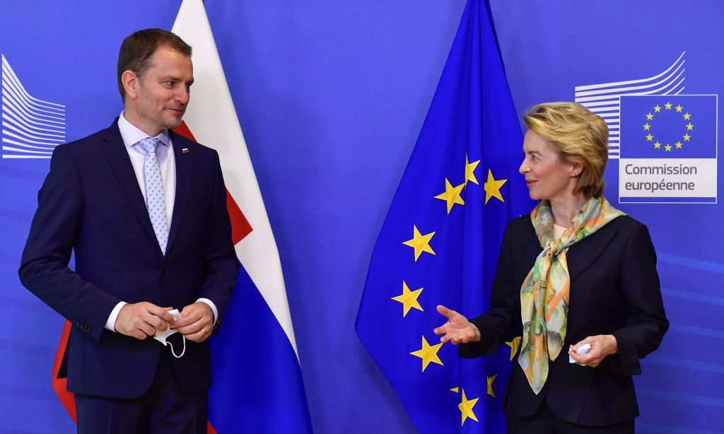 European Commission President Ursula von der Leyen, right, welcomes Slovakia's Prime Minister Igor Matovic prior to a meeting at the European Council ...