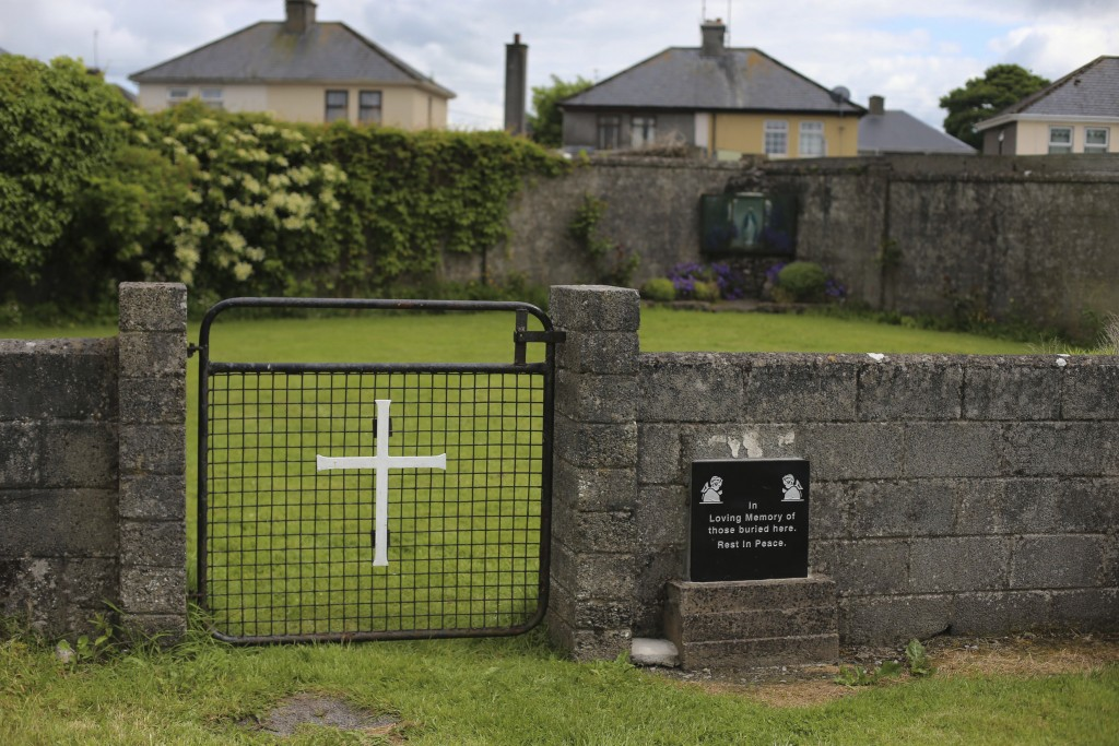 FILE - This June 4, 2014 file photo shows the site of a mass grave for children who died in the Tuam mother and baby home, in Tuam, County Galway, Ire...