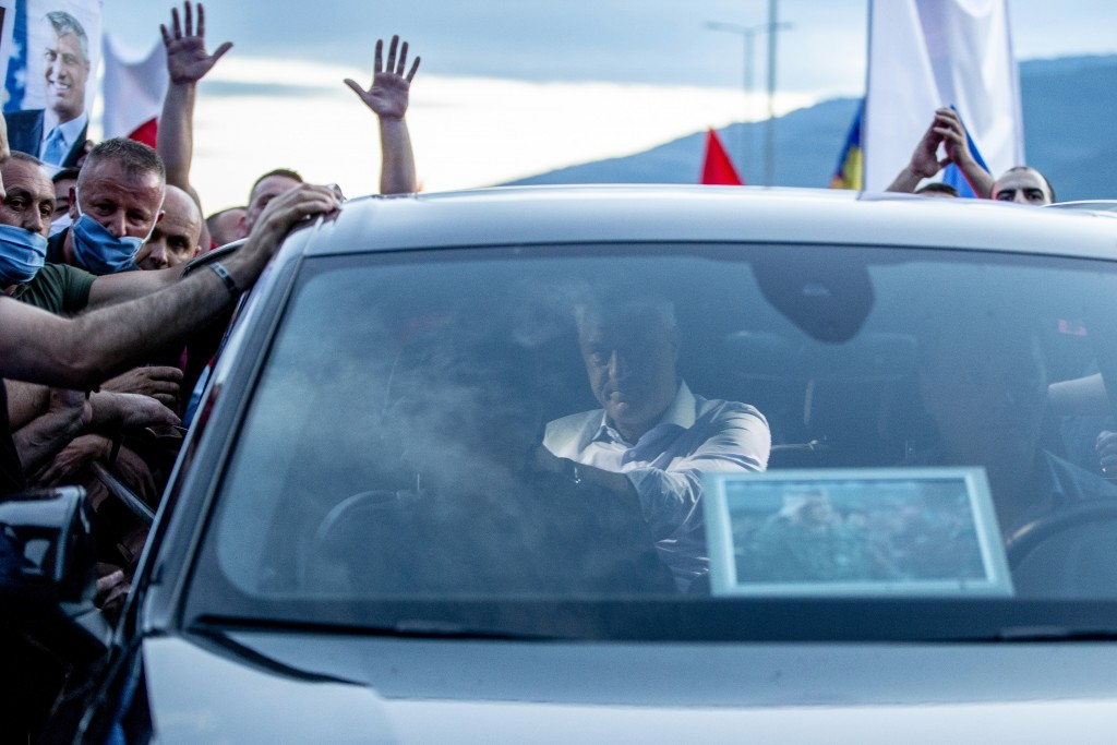 Hundreds of former members of the so-called Kosovo Liberation army, which fought for independence from Serbia, and other supporters cheer at President...