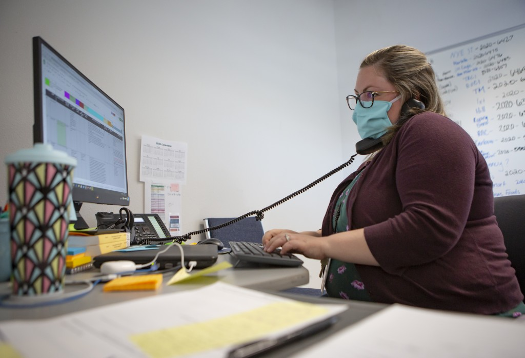 Heather Griggs, operations chief of the Umatilla County Public Health Department COVID-19 contact tracing center in Pendleton, Ore., checks in with pu...