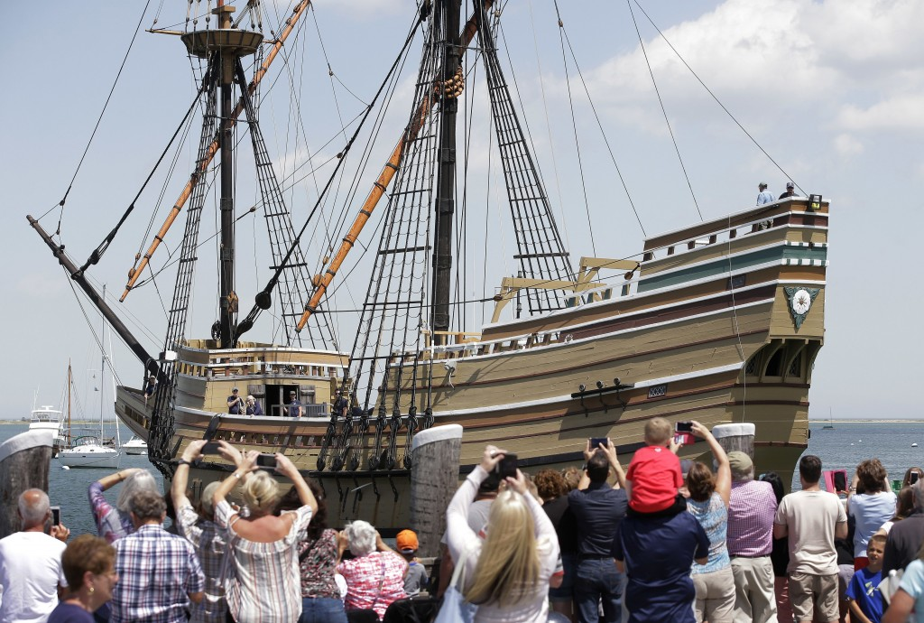FILE - In this June 6, 2016 file photo, people on a wharf watch as the Mayflower II arrives in Plymouth Harbor in Plymouth, Mass. After undergoing mor...