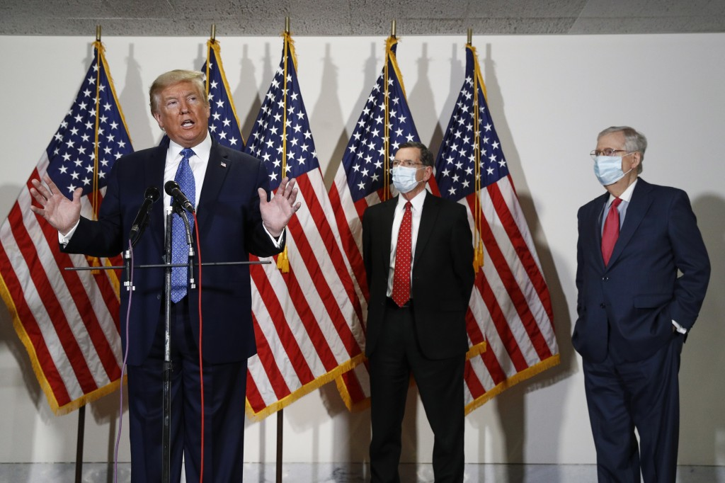 FILE - In this May 19, 2020, file photo President Donald Trump speaks with reporters after meeting with Senate Republicans at their weekly luncheon on...