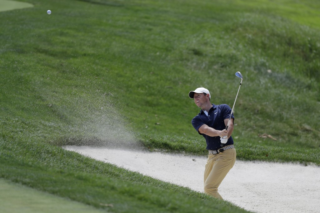 Rory McIlroy, of Northern Ireland, hits from a bunker toward the fourth hole during the second round of the Memorial golf tournament, Friday, July 17,...