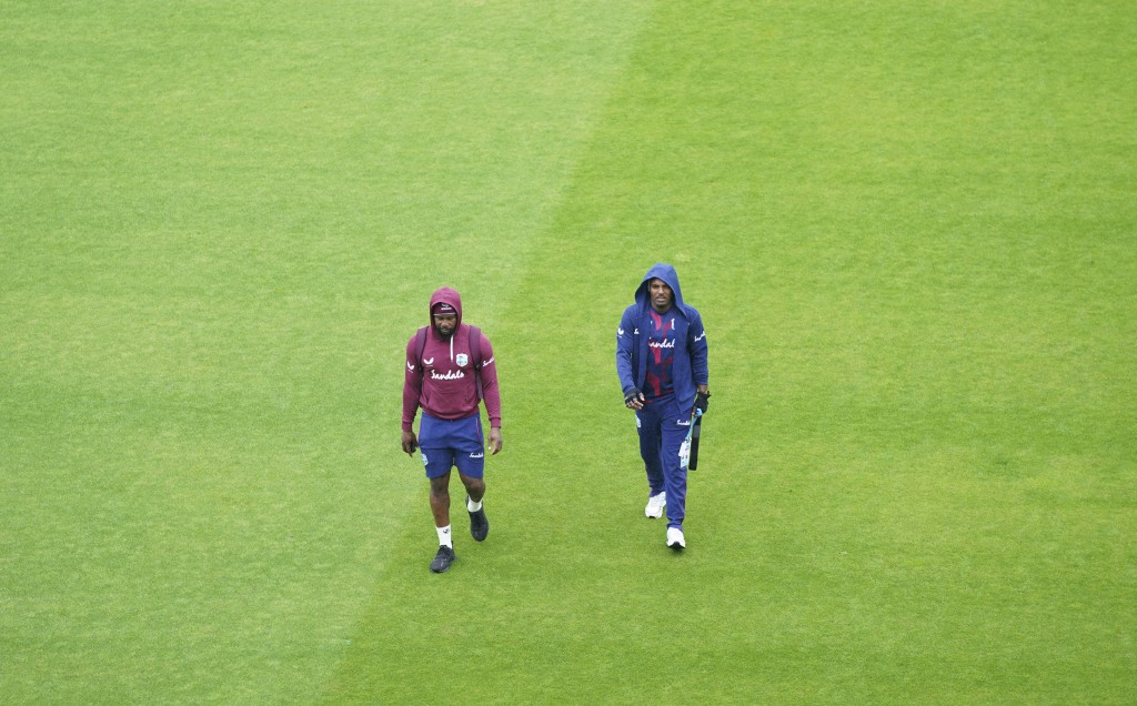 Members of West Indies squad walk through the field as rain delayed the start of the third day of the second cricket Test match between England and We...