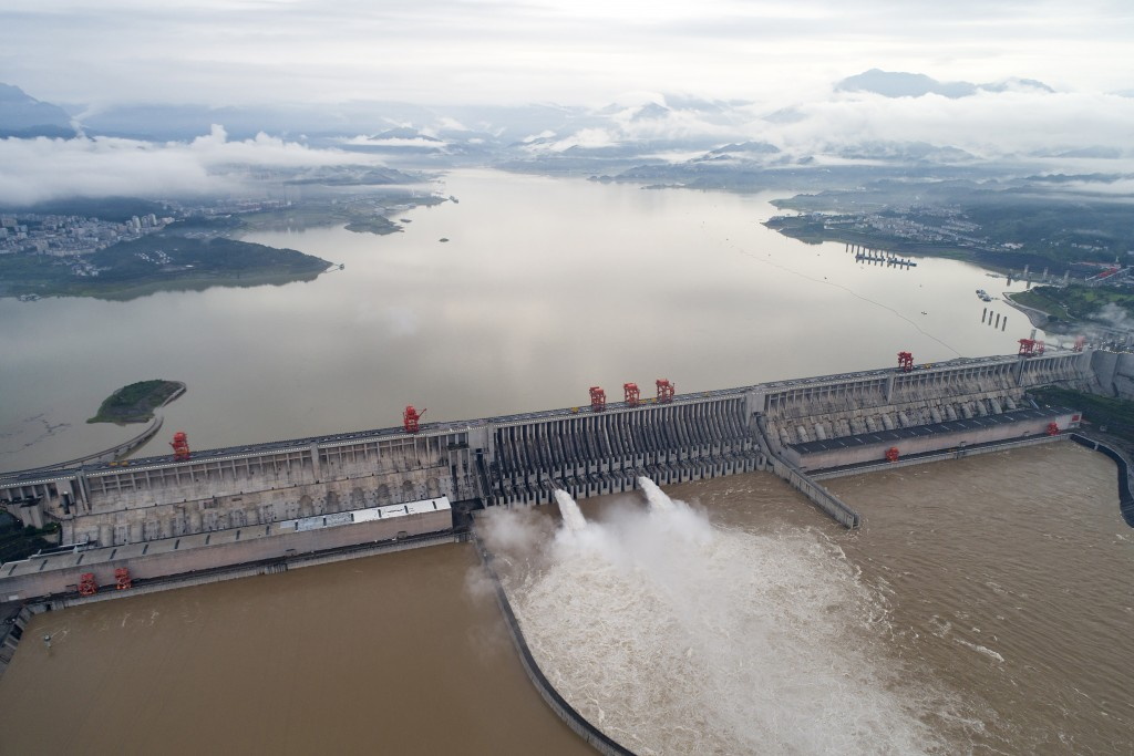 In this photo released by China's Xinhua News Agency, water flows out from sluiceways at the Three Gorges Dam on the Yangtze River near Yichang in cen...