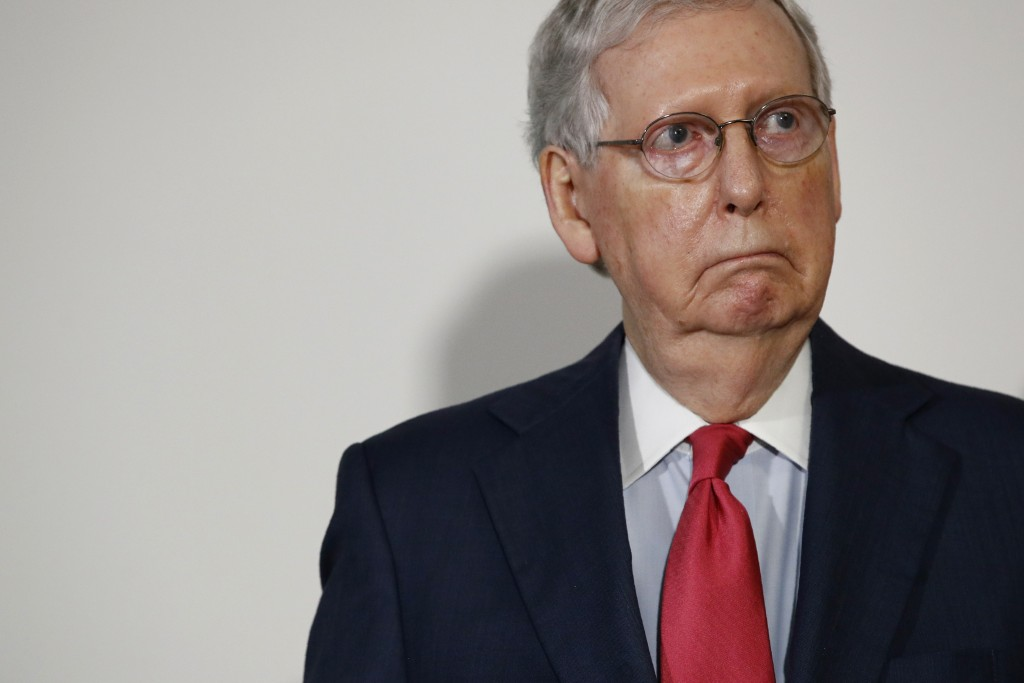 FILE - In this May 19, 2020, file photo Senate Majority Leader Mitch McConnell of Ky., attends a press conference after meeting with Senate Republican...