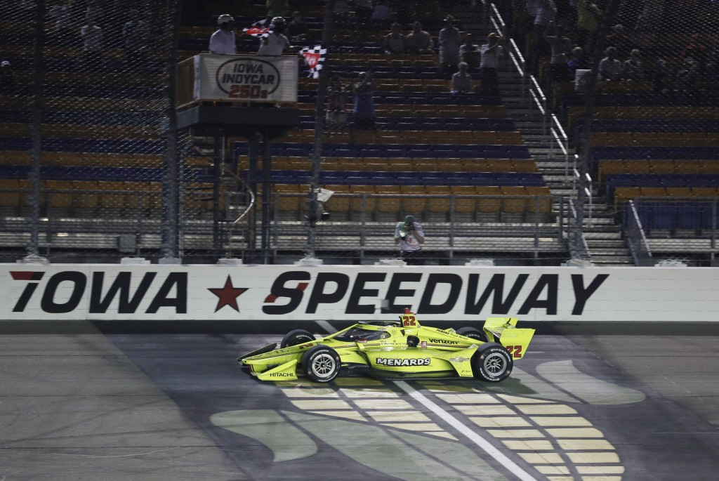 Simon Pagenaud, of France, crosses the finish line as he wins an IndyCar Series auto race Friday, July 17, 2020, at Iowa Speedway in Newton, Iowa. (AP...