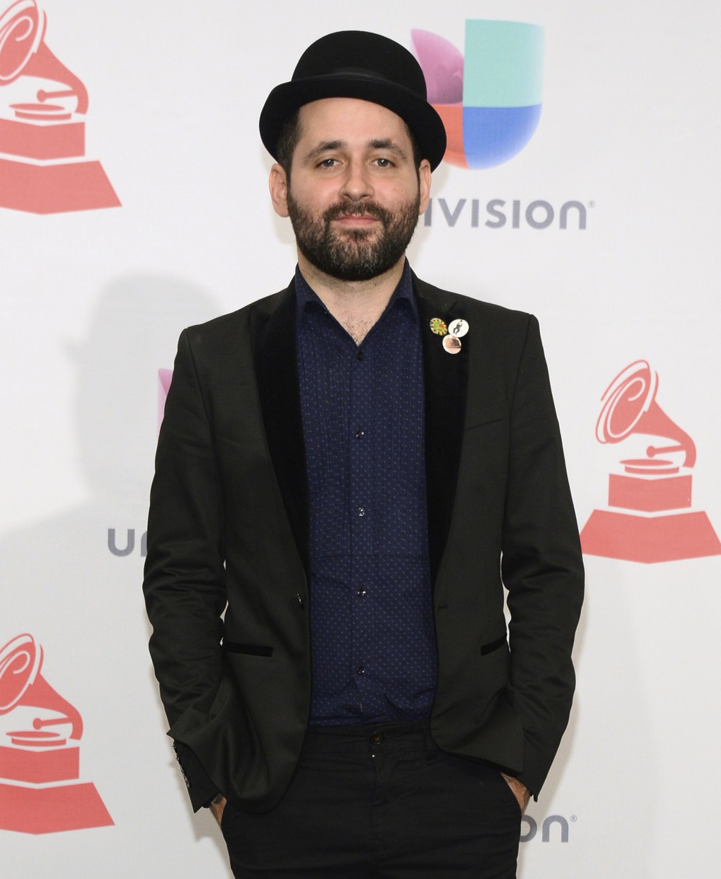 FILE - In this Nov. 19, 2015, file photo, Eduardo Cabra, of Calle 13, poses in the press room at the 16th annual Latin Grammy Awards in Las Vegas. Cab...