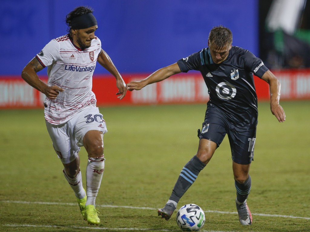 Real Salt Lake defender Marcelo Silva (30) and Minnesota United midfielder Robin Lod (17) battle for the ball during the first half of a soccer match ...