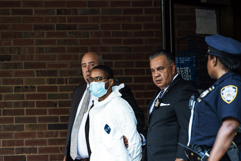 Tyrese Haspil, 21, is escorted out of the 7th precinct by NYPD detectives, Friday, July 17, 2020, in New York. Haspil faces a murder charge in the dea...