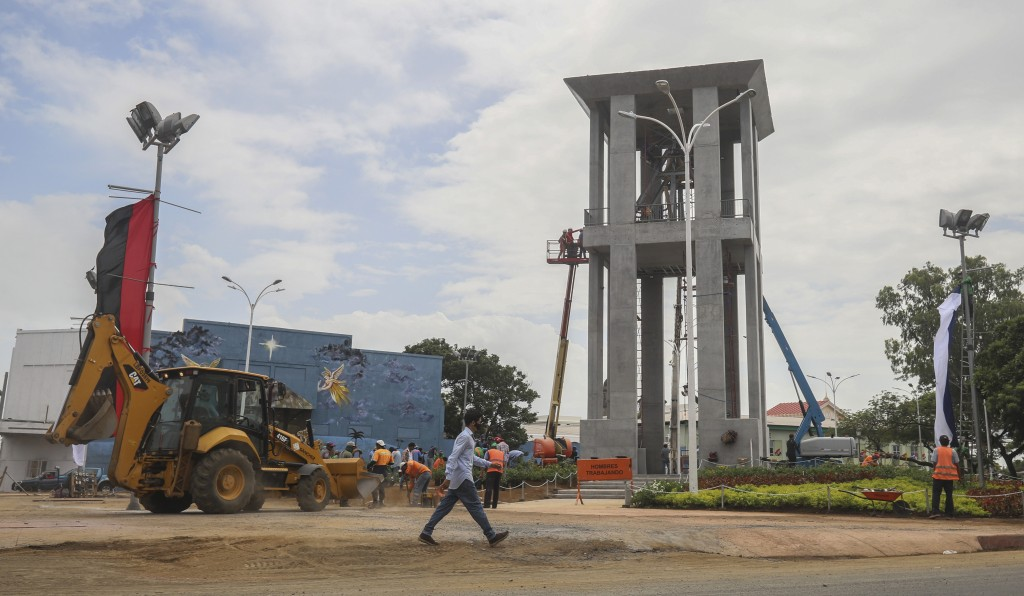 Workers ready a new monument, called the Peace Bell, before its inauguration ceremony later in the day in Managua, Nicaragua, Friday, July 17, 2020. N...