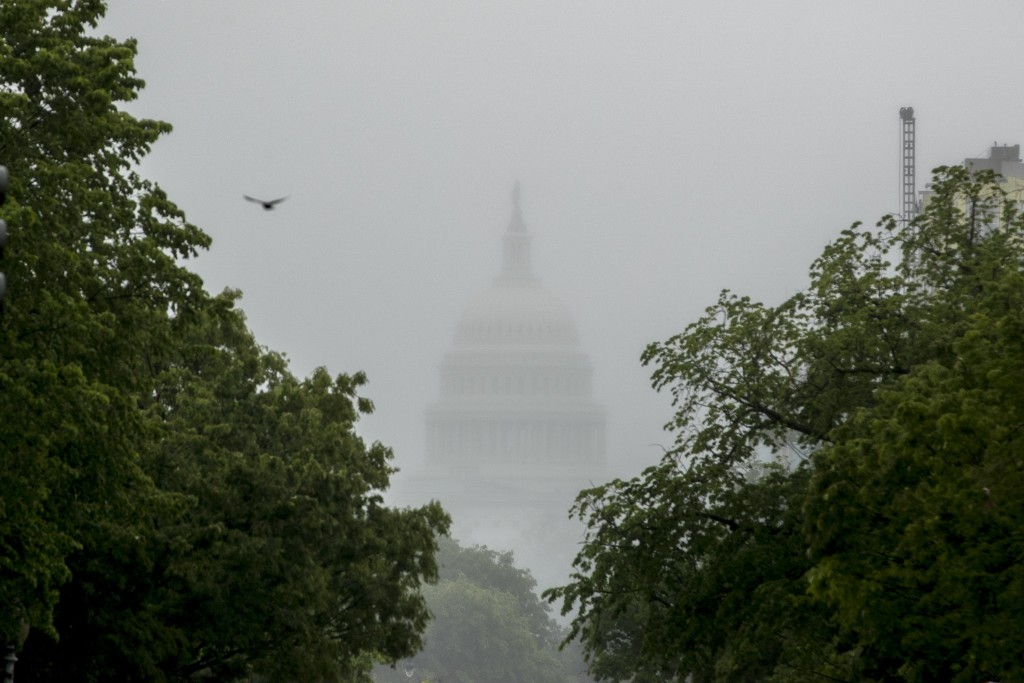 FILE - In this May 22, 2020, file photo the Dome of the U.S. Capitol Building is visible through heavy fog in Washington. With COVID-19 cases hitting ...
