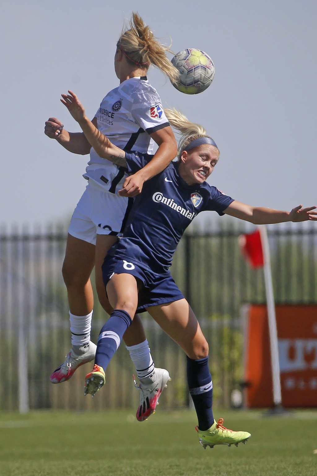 Portland Thorns' Lindsey Horan, left, and North Carolina Courage's Denise O'Sullivan (8) battle for the ball during the first half of an NWSL Challeng...