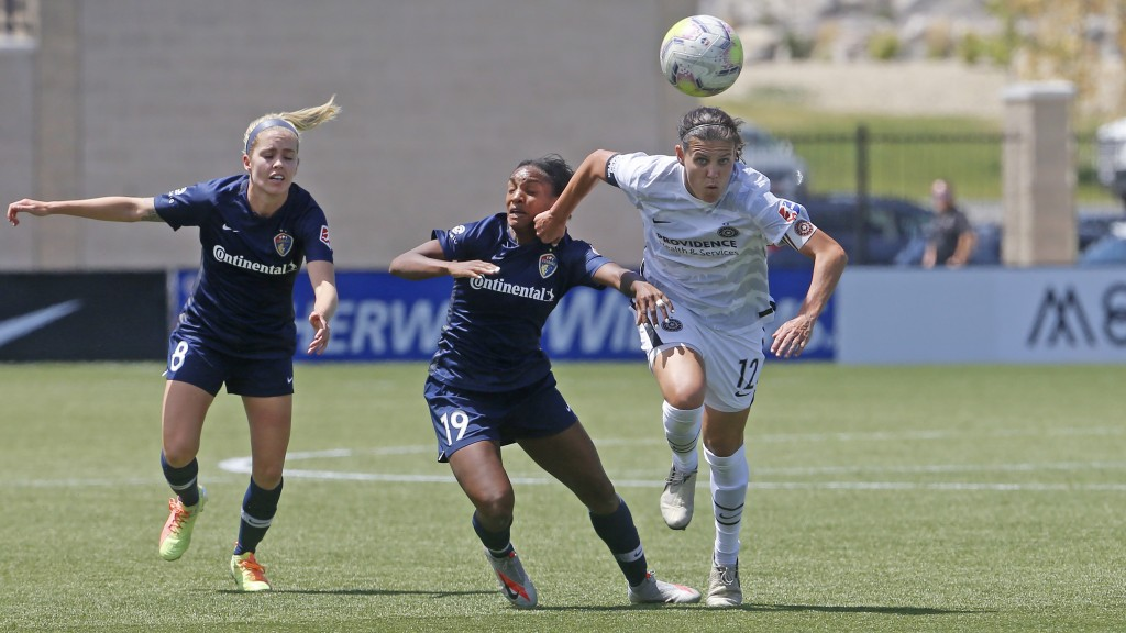 Portland Thorns' Christine Sinclair (12) battles with North Carolina Courage forward Crystal Dunn (19) during the second half of an NWSL Challenge Cup...