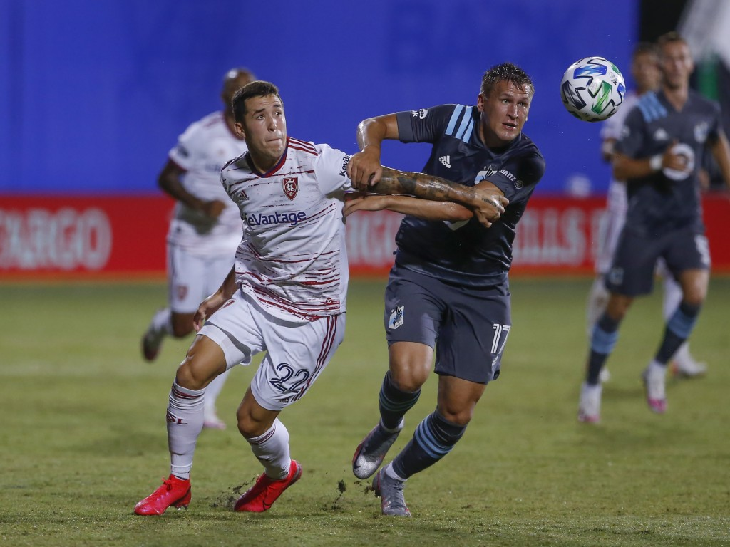 Real Salt Lake defender Aaron Herrera (22) and Minnesota United midfielder Robin Lod (17) battle for the ball during the first half of a soccer match ...